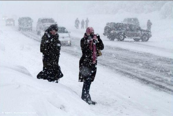 Дощ, сніг та шторм: в Україну увірветься активний циклон (Прогноз на тиждень)